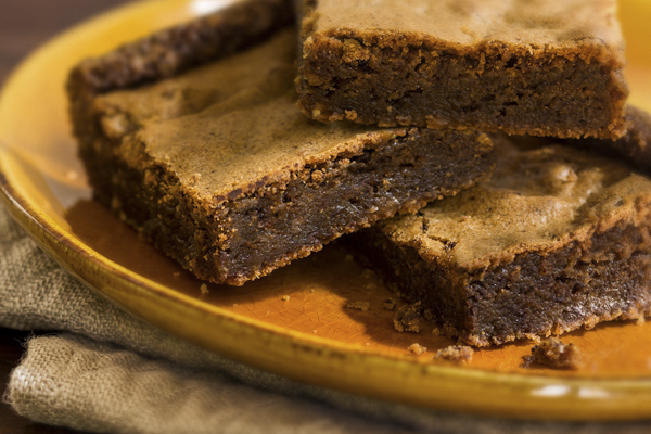chocolate pumpkin brownies for the fall on an orange plate
