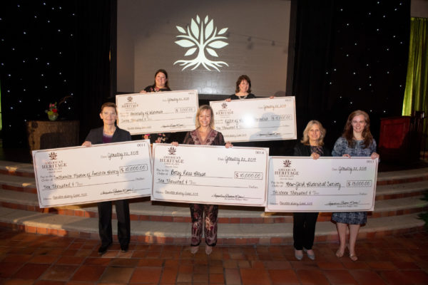 grant winners holding their checks from american heritage chocolate