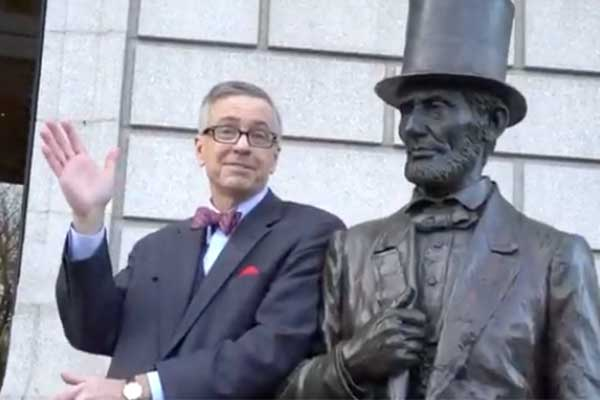 Professor B posing with statue of Abraham Lincoln