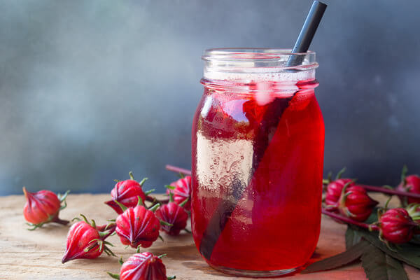 hibiscus drink in a glass jar with straw